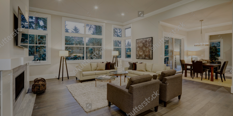 stock-photo-chic-light-living-room-design-with-dark-floors-furnished-with-glass-top-accent-tables-and-beige-557475709